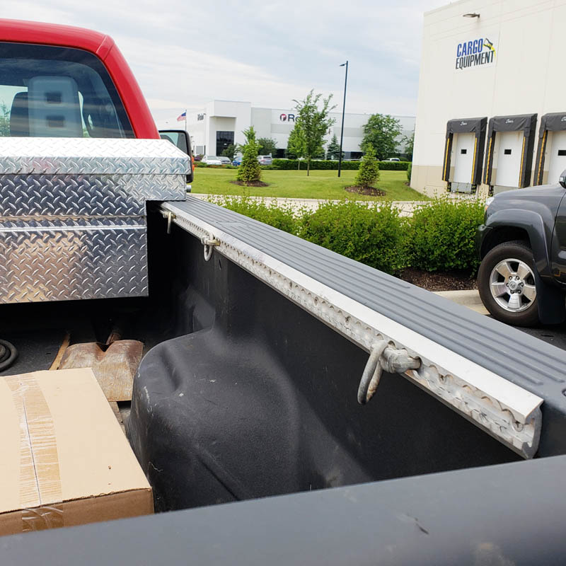 Aircraft grade heavy-duty l track installed pickup truck